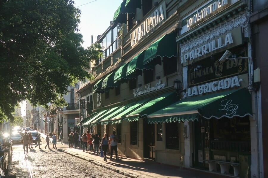 A cobblestone street in front of colonial buildings in San Telmo Argentina
