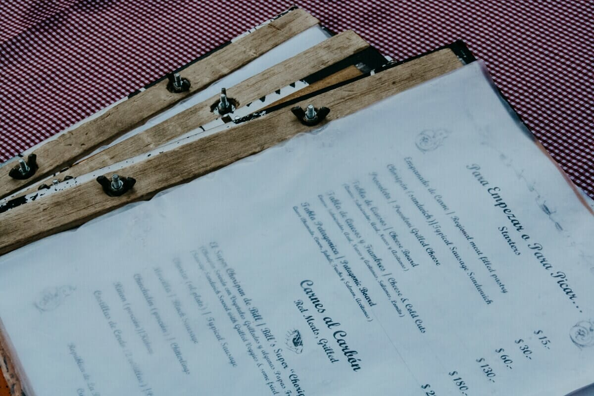 Three menus on a red checkered table