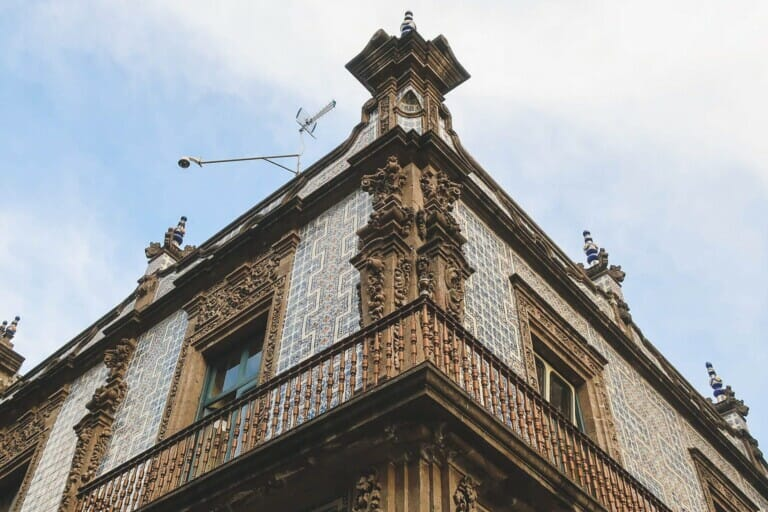 A blue and white tiled colonial building