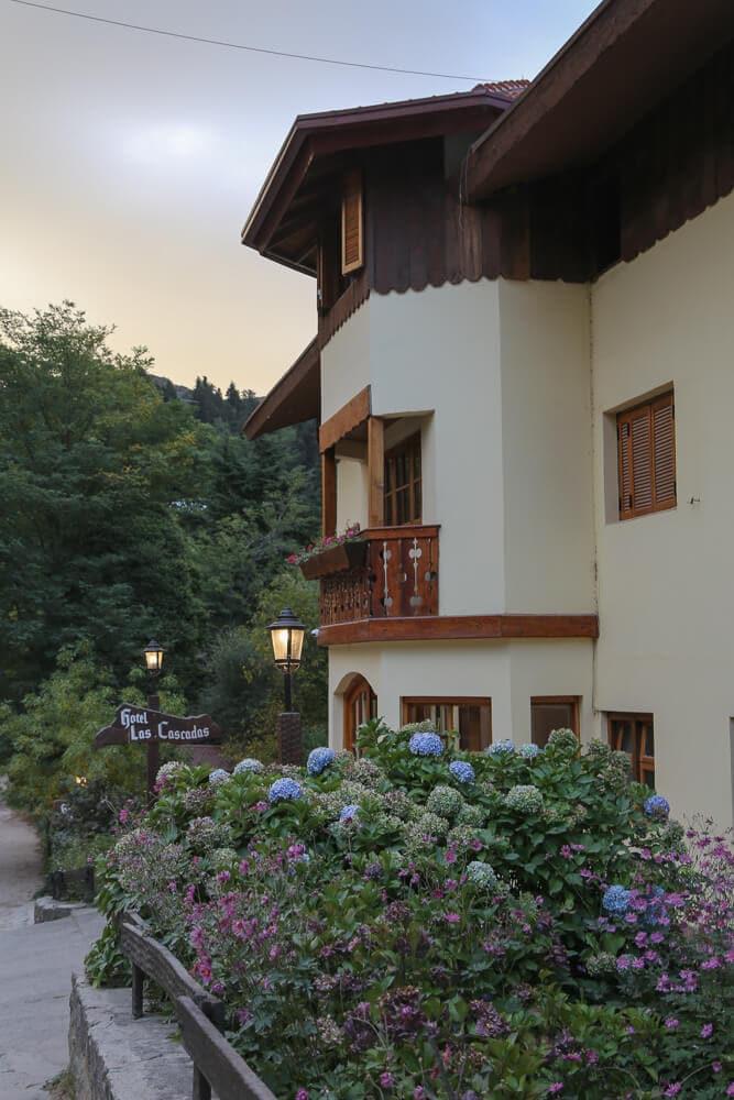 An alpine building behind hydrangea flowers