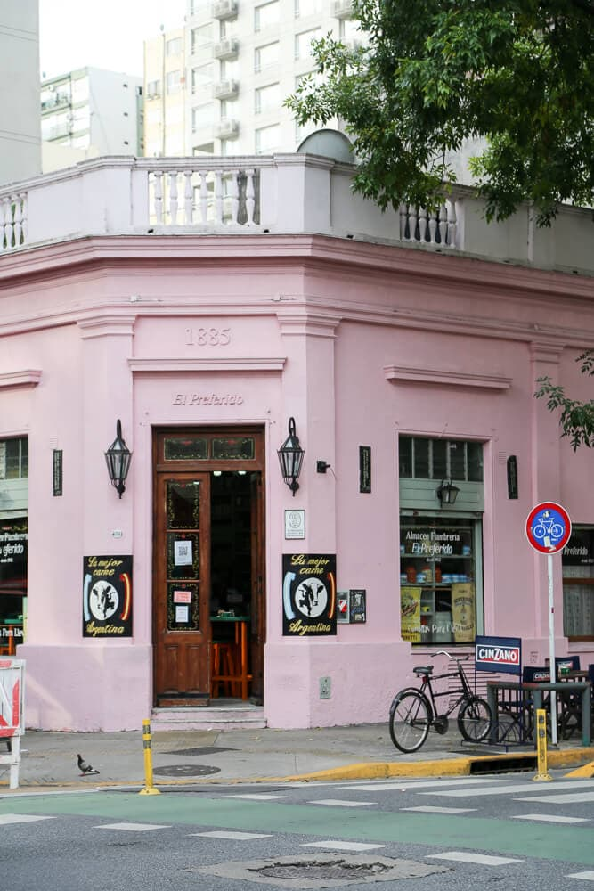 A pink building on a street corner