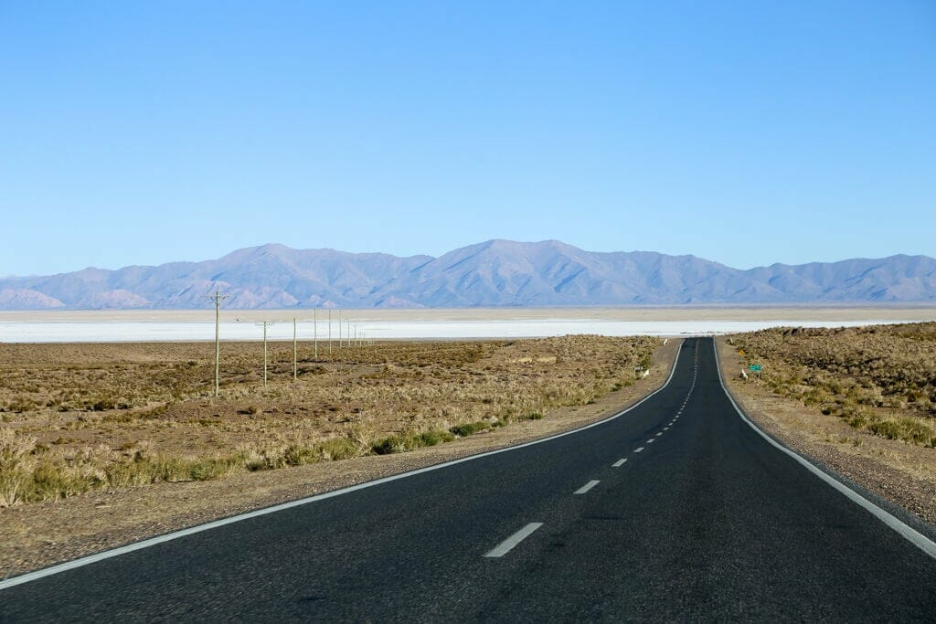 A two lane highway in the desert