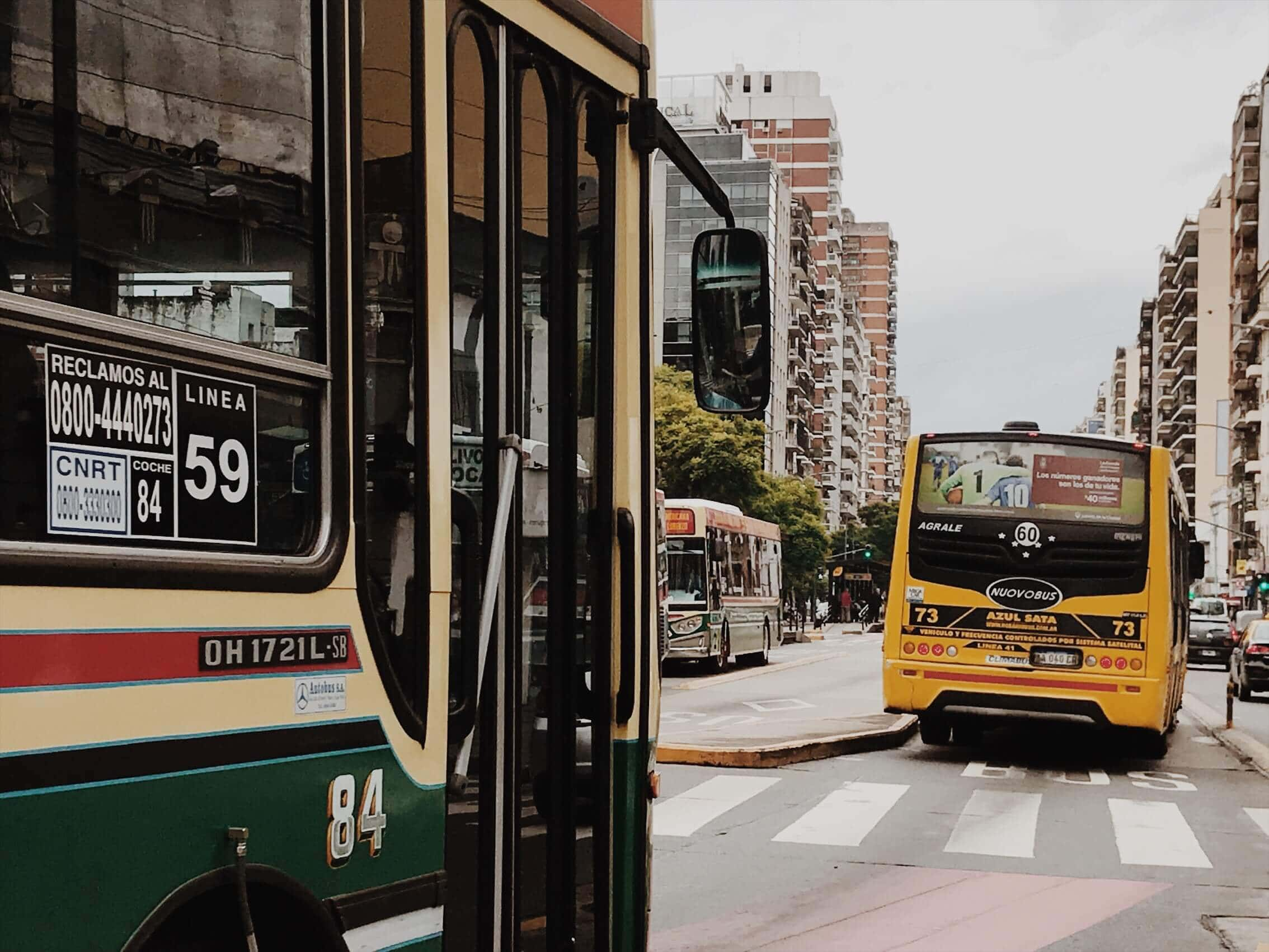City buses on a busy avenue