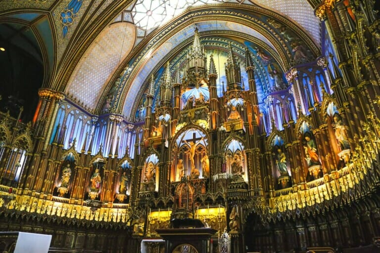A golden alter and blue arches in Montreal Basilica