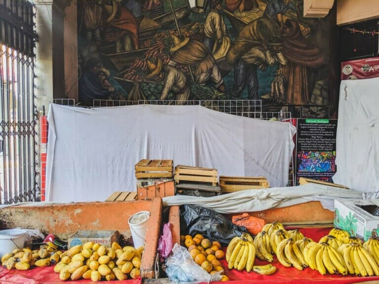 Bananas and mangos on red tablecloths in a Mexico City market