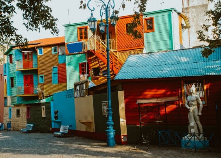 A colorful street with rainbows of colors painted on the walls
